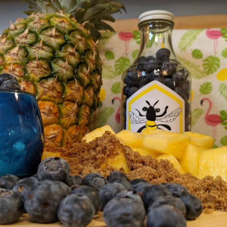 Pineapple, blueberries, and brown sugar as ingredients for mead